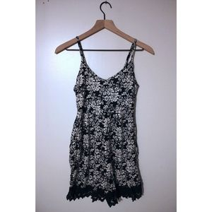 Xhilaration sleeveless romper with floral pattern